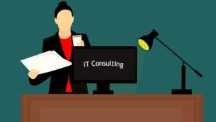 """IT consulting"" written on desktop"