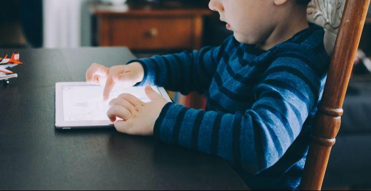 Kid using iPad